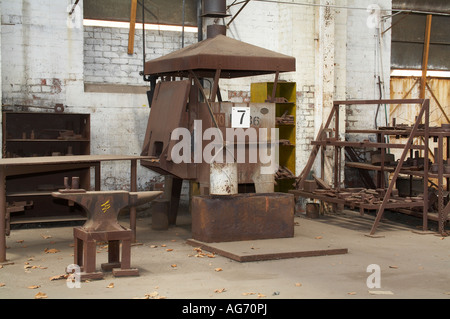 furnace and foundry area in an abandoned historic railway workshop - Stock Photo