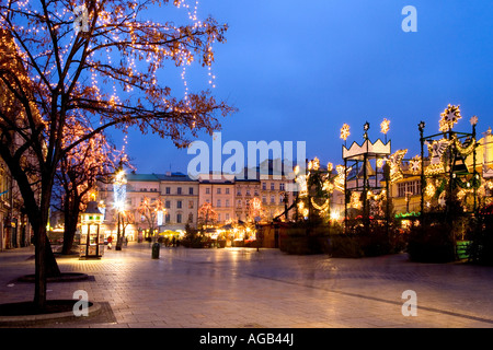 Christmas Xmas lights around the main square and market in Krakow Cracow Poland - Stock Photo