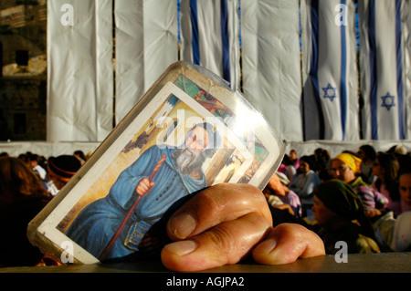 Jewish worshiper holding religious talisman during Prayer at the Western wall Jerusalem Israel - Stock Photo