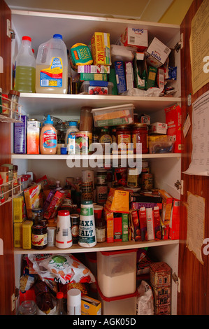 Over stocked larder in country home with teenagers dsc 0822 - Stock Photo