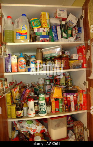 Over stocked larder in country home with teenagers dsc 0826 - Stock Photo