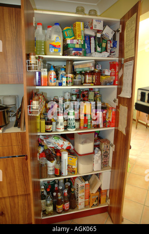 Over stocked larder in country home with teenagers dsc 0831 - Stock Photo
