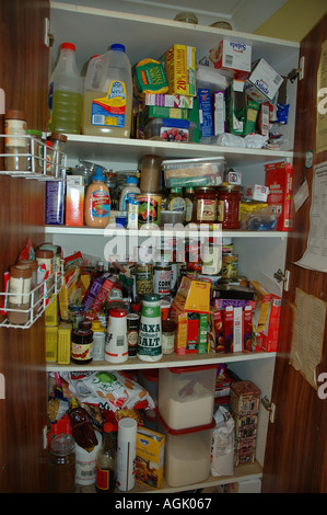 Over stocked larder in country home with teenagers dsc 0837 - Stock Photo