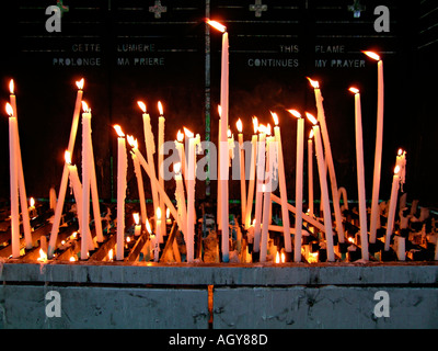 candles of prayer of the pilgrims in Lourdes Hautes Pyrénées France - Stock Photo