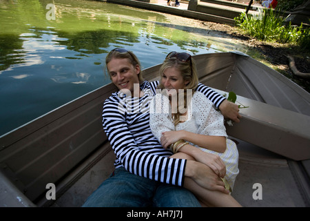 Young couple reclining in a boat and smiling - Stock Photo