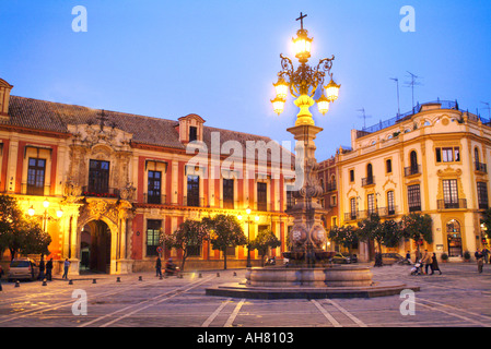 Santa Cruz District Plaza Virgen de los Reyes with Palacio Arzobispal on the left with fountain Andalusia - Stock Photo