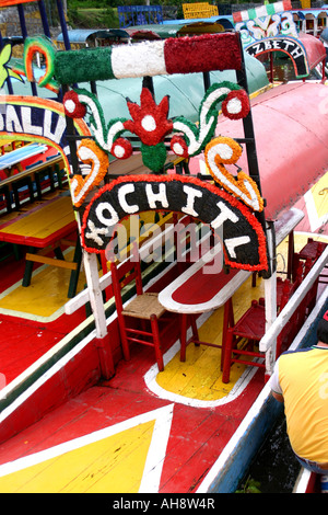 Colorful decorated boats at the town of Xochimilco at Mexico - Stock Photo