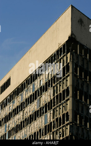 Bomb damaged building in Mostar in Bosnia Herzegovina standing more than 10 years after the Bosnian War finished - Stock Photo