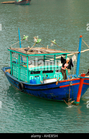 Vietnam , Halong Bay , fishing boat , leaves floating village , with lights to lure fish & squid into nets at night - Stock Photo