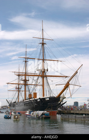 HMS Warrior at Portsmouth Hampshire England; first Royal Navy armour-plated warship - Stock Photo