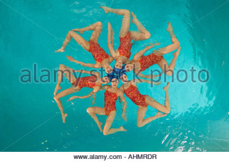Synchronized swim team practicing - Stock Photo