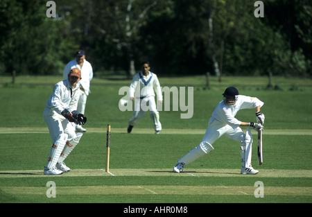 Action during village cricket match at Wellesbourne, Warwickshire, England, UK - Stock Photo