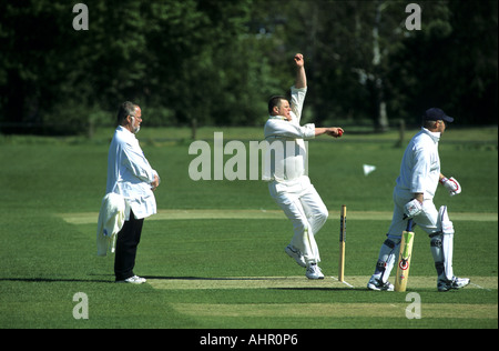 Man bowling during village cricket match at Wellesbourne, Warwickshire, England, UK - Stock Photo