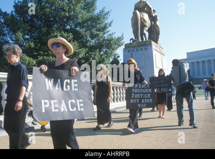 Anti war protester in black marching at rally Washington D C - Stock Photo