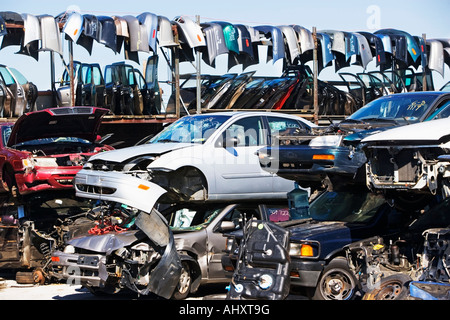 Cars and car parts in junkyard - Stock Photo