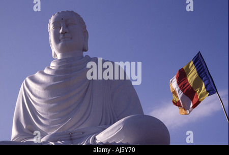 the big 14m high white Buddha is visible from all over the city of Nha Trang - Stock Photo