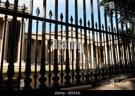 The British Museum, protected by iron railings outside the main entrance - Stock Photo