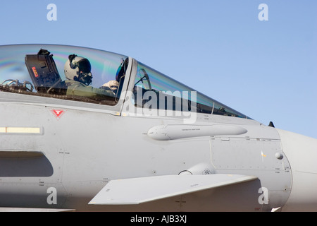 Close up of the cockpit and pilot of a Eurofighter Typhoon military jet fighter plane - Stock Photo