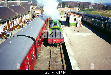 steam engine passing carriages at boat of garten station strathspey railway highlands scotland europe - Stock Photo