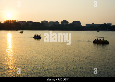 sunset on Lake Beihai Beihai Park Beijing China - Stock Photo