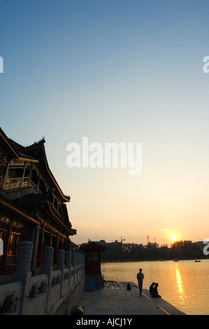 sunset on Lake Beihai and a Chinese pavilion Beihai Park Beijing China - Stock Photo