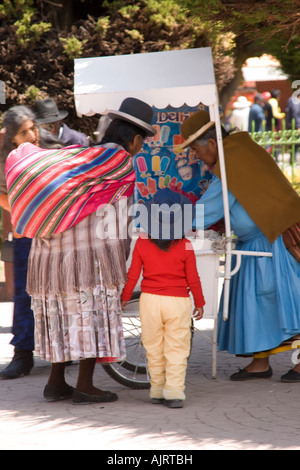 Aymara women in the Plaza 2 de Febrero in Copacabana a town on the shores of Lake Titicaca, Bolivia near the border - Stock Photo