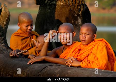 Cambodia Siem Reap Monks in evening sun at Angkor Wat - Stock Photo