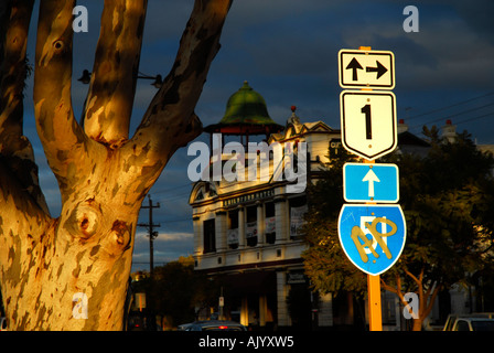 last light of sunset shines on highway street sign, sugar gum and Guildford hotel in background. Guildford, Western - Stock Photo