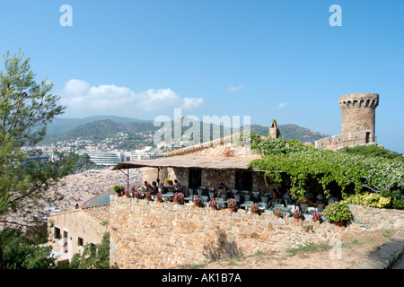 View from the Castle with a restaurant terrace in the foreground, Tossa de Mar, Costa Brava, Catalunya, Spain - Stock Photo
