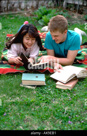 Japanese student & US host, age 18 studying English in his yard. St Paul Minnesota USA - Stock Photo