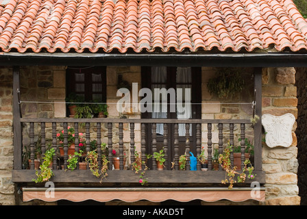 Wooden balcony on stone house in village of Barcena Mayor, Cantabria, Northern Spain - Stock Photo