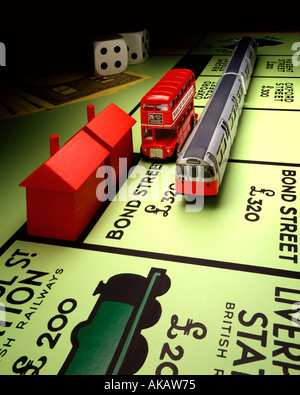 London Transport and Monopoly Board Monopoly and routemaster bus with underground train on Bond Street next stop - Stock Photo