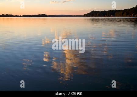 Clouds reflected in Municky Rybnik lake Hluboka Czech republic - Stock Photo
