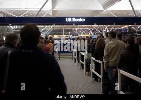 People queuing at immigration UK border, Stansted airport, London, England, Europe. - Stock Photo