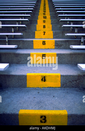Numbered ascending steps in a sports stadium - Stock Photo