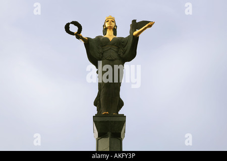 The statue of Sofia guarding and protecting the city of Sofia in Bulgaria The symbols represent fame and wisdom - Stock Photo