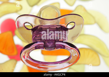 pacifier over sweets - Stock Photo