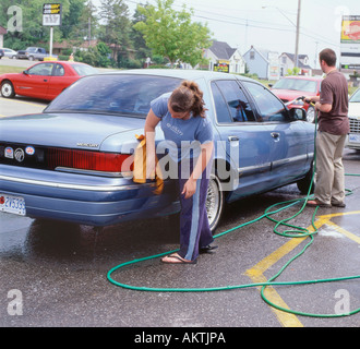 Young volunteers washing cars for a community carwash in Fort Erie, Ontario, Canada - Stock Photo