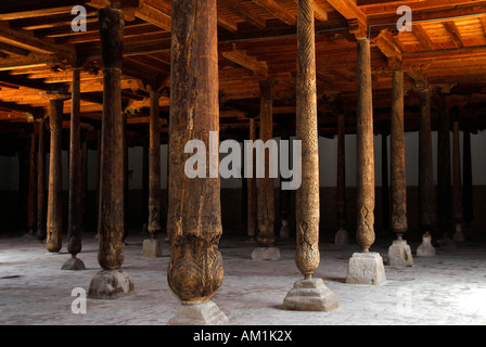 Many old wooden columns in Djuma Mosque old town Khiva Uzbekistan - Stock Photo