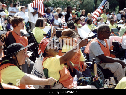 A crowd of people with disabilities waving flags and shouting at a national disability civil rights event in Washington, - Stock Photo