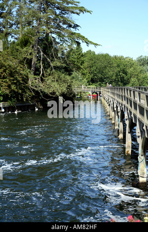 Run off from Weir on river Thames at Henley and footbridge over river - Stock Photo