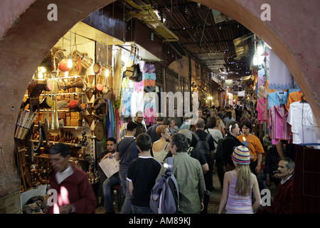 Tourists in a souk in the old part of town, Mrrakech, Morocco - Stock Photo