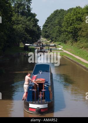 NARROW BOAT BETWEEN LOCKS in Audlem Flight at Coxbank on 'Shropshire Union' Canal Audlem Cheshire England UK - Stock Photo
