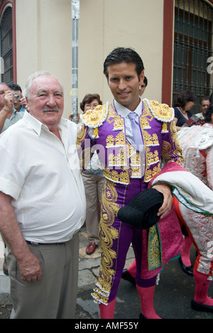Antonio Manuel Punta, Spanish bullfighter, posing with an aficionado or fan before a bullfigt at Real Maestranza - Stock Photo