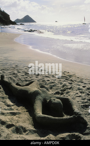 Sand sculpture on beach of Becune Bay at the Le Sport Resort and Spa on St Lucia - Stock Photo