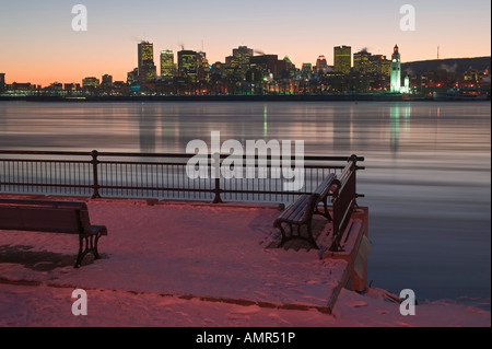 st. lawrence river, pack ice, after sunset, downtown montreal seen from parc jean-drapeau, montreal, Quebec, Canada - Stock Photo