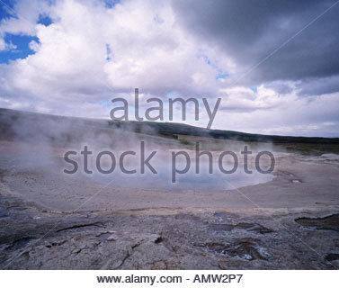 Steam rising from a hot spring - Stock Photo