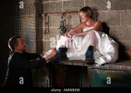 Young man proposing to his girlfriend in an old building Young man is holding a ring - Stock Photo
