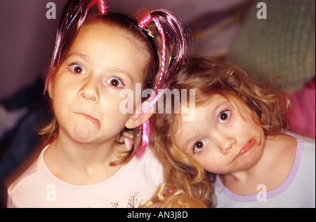 Two young girls making funny faces - Stock Photo