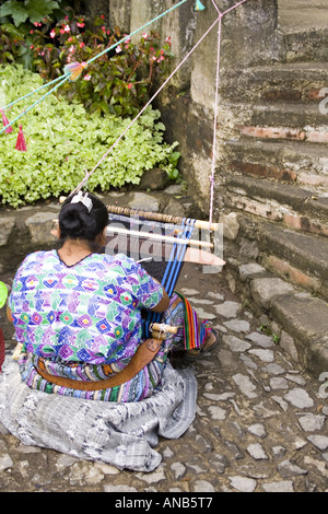 GUATEMALA ANTIGUA Cakchiquel Mayan woman wearing traditional huipil and corte - Stock Photo